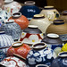 Various bowls displayed for sale on the street in Asakusa by DigiPub