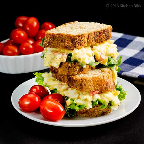 Egg Salad Sandwich on plate with tomatoes