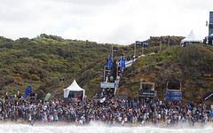 Carissa Moore gets chaired up the stairs as a Rip Curl Pro champion.
