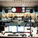 NPR's new studio: The POV from the host's chair. The red one-line telephone used by Steve Inskeep and Renee Montagne, Scott Simon's reading stand from Chicago, RPG diffusor panels, some of the clocks, and coffee mug are familiar surroundings transferred f