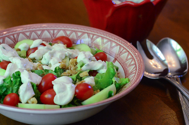Light and Creamy Blue Cheese Dressing on top of a salad.