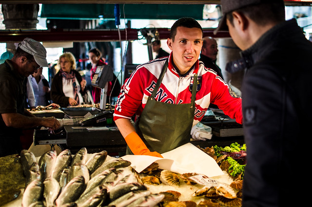 A fish monger at the Rialto Market in Venice, Italy