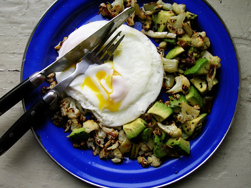 fried eggs with avocado cauliflower hash