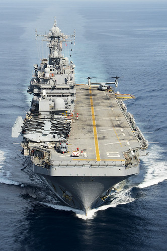 SINGAPORE (NNS) -- The amphibious assault ship USS Peleliu (LHA 5) pulled into Changi Naval Base for a scheduled port call following completion of Amphibious Landing Exercise (PHIBLEX) 2015.