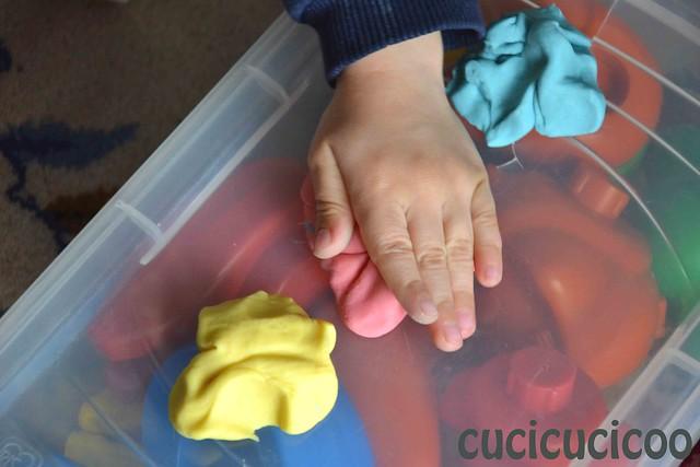 squashing handmade play doh