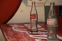 soft drink(0.0), carbonated soft drinks(0.0), drink(0.0), cola(0.0), beer(0.0), alcoholic beverage(0.0), red(1.0), bottle(1.0), coca-cola(1.0),
