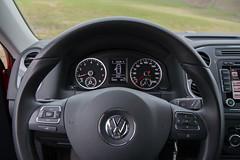automotive exterior(0.0), wheel(0.0), rim(0.0), automobile(1.0), volkswagen tiguan(1.0), volkswagen(1.0), vehicle(1.0), steering wheel(1.0), land vehicle(1.0),