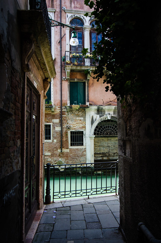 A peekaboo view wandering the narrow alleys of Venice, Italy.