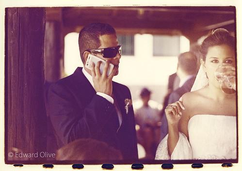 Groom on phone and bride on white wine - Edward Olive European destination wedding photographer by Edward Olive Actor Photographer Fotografo Madrid