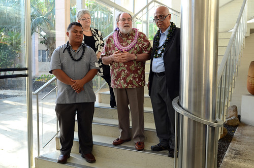 <p>Governor Abercrombie addresses the crowd at a reception for outgoing regents Mike Dahilig, left, and Judge Artemio Baxa, right, and incoming regents at Bachman Hall Thursday night.</p>