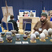 Pat Joyce exhibiting his pottery by bluebus