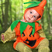 baby in a halloween pumpkin costume