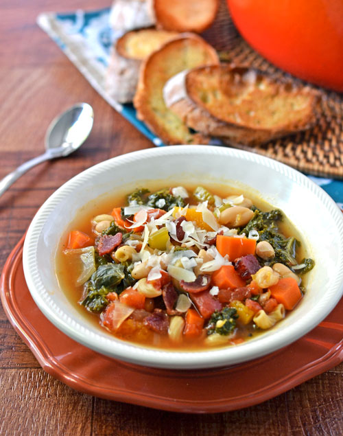 Minestrone Soup with Butternut Squash in a white bowl topped with cheese