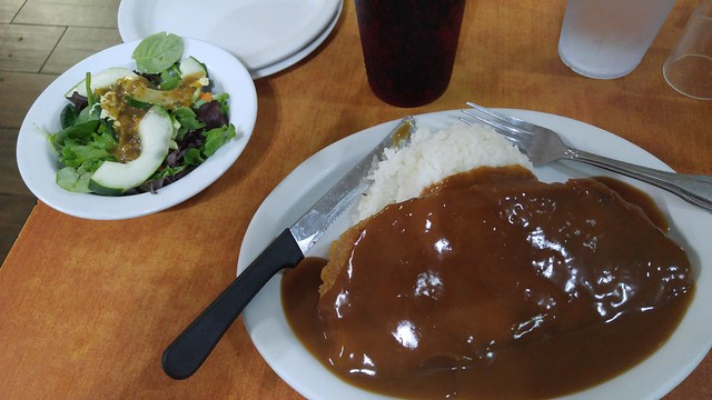 Chicken fried steak with rice and brown gravy