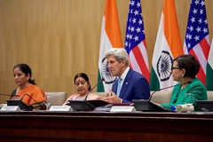 U.S. Secretary of State John Kerry sits with Indian Minister of External Affairs Shushma Swaraj, Indian Commerce Minister Nirmala Sitharama, and U.S. Commerce Secretary Penny Pritzker as he addresses reporters during a news conference on August 30, 2016, at the Jawarhalal Nehru Bhawan in New Delhi, India, following the annual U.S.-India Strategic and Commercial Dialogue. [State Department Photo/ Public Domain]
