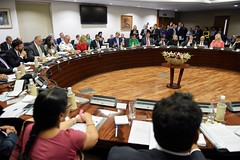U.S. Secretary of State John Kerry, U.S. Commerce Secretary Penny Pritzker, and their delegation sit across from Indian Minister of External Affairs Shushma Swaraj, Indian Commerce Minister Nirmala Sitharama, and their counterparts on August 30, 2016, at the Jawarhalal Nehru Bhawan in New Delhi, India, before the opening session of the annual U.S.-India Strategic & Commercial Dialogue. [State Department Photo/ Public Domain]