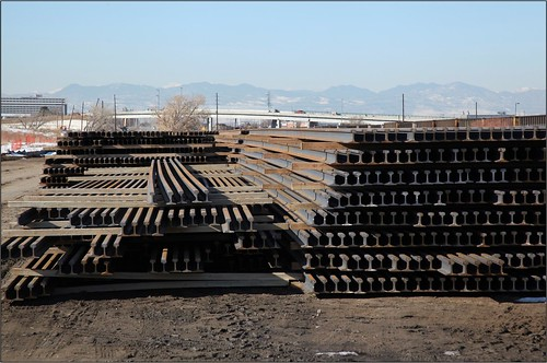 Photo of stacks of steel rail at welding yard