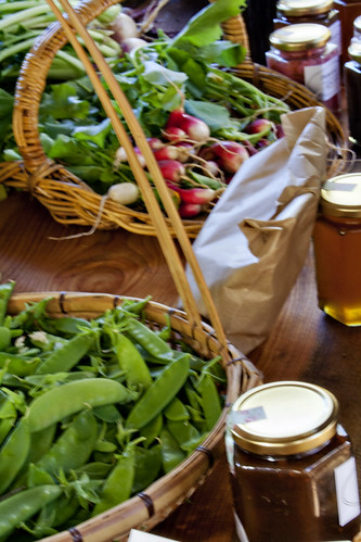 Photo of local honey in jars, radishes, chard and greens at the Farm Stand