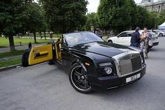 supercar(0.0), automobile(1.0), automotive exterior(1.0), rolls-royce(1.0), wheel(1.0), vehicle(1.0), performance car(1.0), automotive design(1.0), rolls-royce phantom coupã©(1.0), rolls-royce phantom(1.0), rolls-royce phantom drophead coupã©(1.0), sedan(1.0), land vehicle(1.0), luxury vehicle(1.0), sports car(1.0),