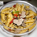 Garganelli pasta with tomatoes and fresh shaved summer black truffles