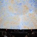 Audience under the cosmic microwave background projection on the dome