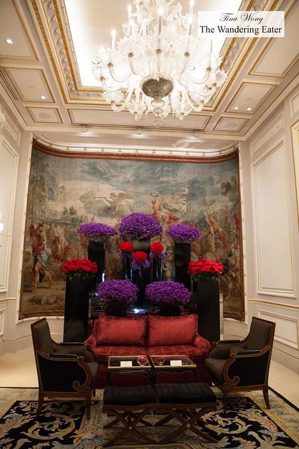 Entrance with glorious floral arrangements to Le Cinq