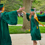 13cmc28 -- Marlena Szewczyk runs to greet Sean Cavenagh after graduating.