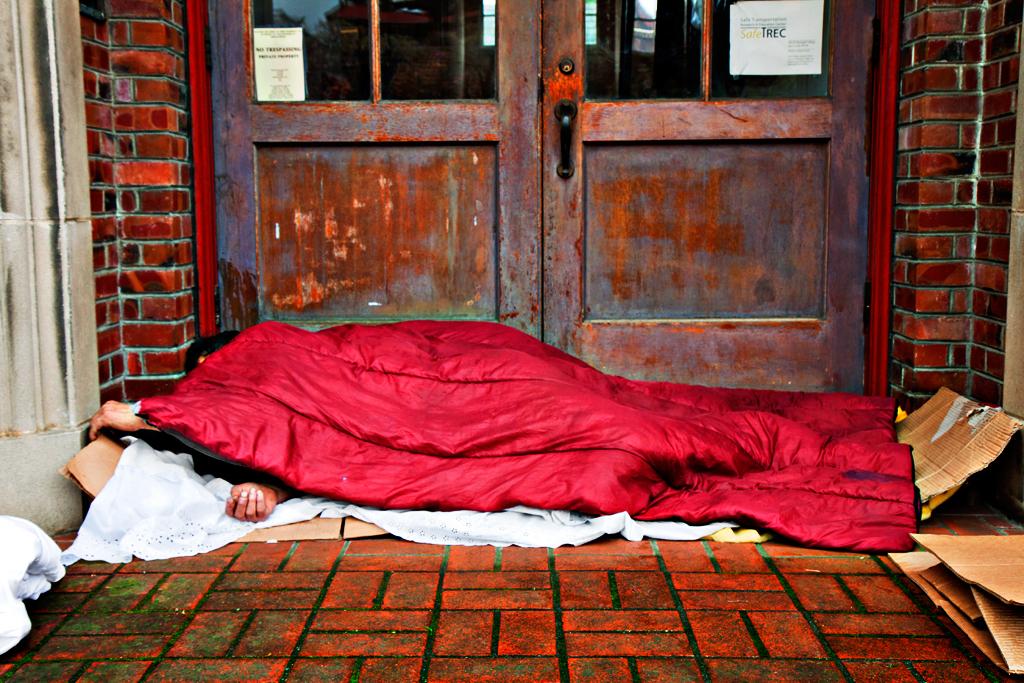 Sleeping-man-outside-wooden-doors-in-3-13--Berkeley