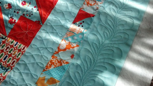 free motion quilting on summer stars quilt