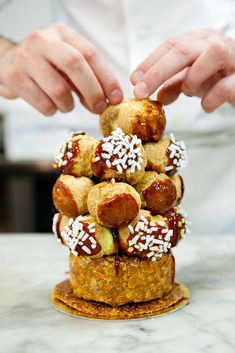 Chef Dominique Ansel building up his croquembouche