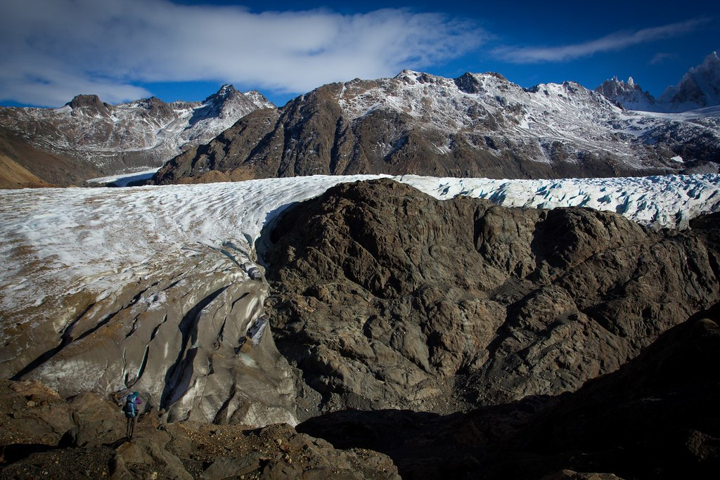 Scouting a route for crossing the Glacier Tunel towards the Paso del Viento, which is at the upperleft corner of the picture. Los Glaciares. Patagonia. Argentina.