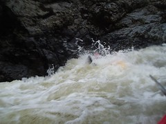 Tim hiding underneath the cushion wave and fighting with the rocks!! Image
