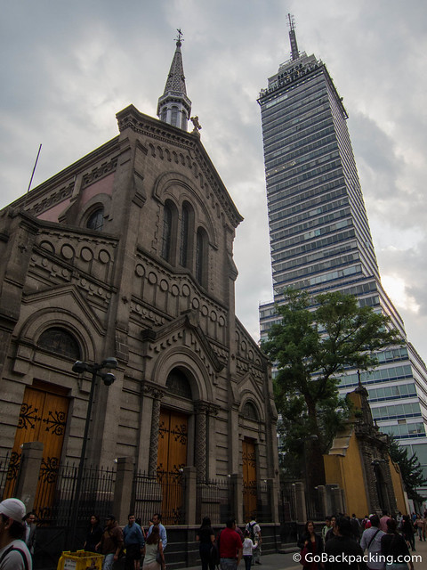 The modern lines of Torre Latinoamericana contrast sharply with a nearby church