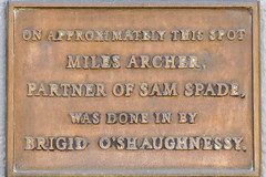 Photo of Dashiell Hammett, Miles Archer, and Brigid O'Shaughnessy  bronze plaque