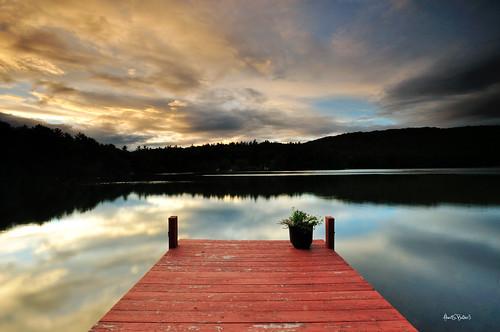 sunset lake reflections dock newengland newhampshire sunsetlake sigma1020mm offcameraflash bryanpeterson leefilters nikond90 blueribbonphotography nikonsb700 understandingflashphotography ndgrad062stophardedge