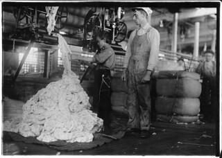 Young boy on warping machine in Elk Cotton Mills. Fayetteville, Tenn, November 1910
