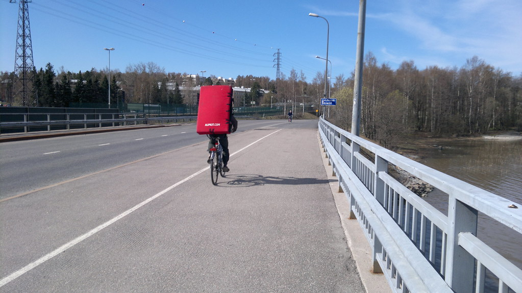 Cycling with a bouldering mat