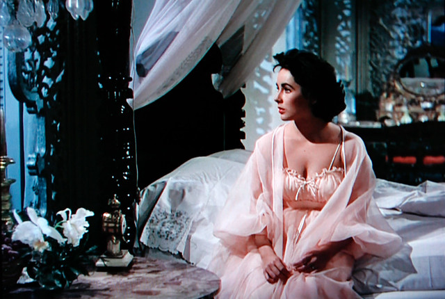 Movie Star Liz Taylor is a Vision of Loneliness in