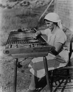 Acadian woman making a rug, Cape Breton, Nova Scotia, 1938 / Femme acadienne en train de confectionner un tapis, cap Breton, Nouvelle-Écosse, 1938