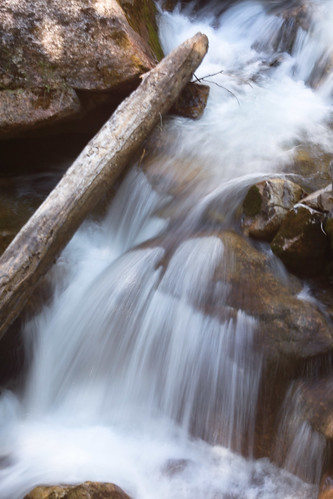 longexposure creek waterfall log colorado