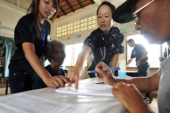 Lt. Cmdr. Tessica Lee works with a Cambodian Army counterpart, right, during a previous Pacific Partnership mission. (U.S. Navy file photo)