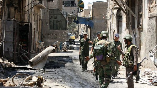 Syrian troops patrol the city of al-Mathan heavily damaged by fighting by loyalists and western-backed rebels. Syria is under threat of regime-change by the imperialist states. by Pan-African News Wire File Photos