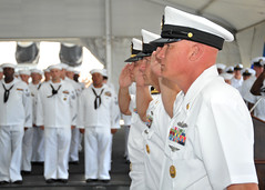 U.S. Pacific Fleet Master Chief John Minyard, foreground; Commander Task Force 73, COMLOG WESTPAC Command Master Chief Robert Shannon; and Chaplain Lt. James Ragain III, salute during the national anthem at the USS Missouri CPO Legacy Academy Class 006 graduation, Aug. 24. (U.S. Navy Photo by Mass Communication Specialist 2nd Class David Kolmel)
