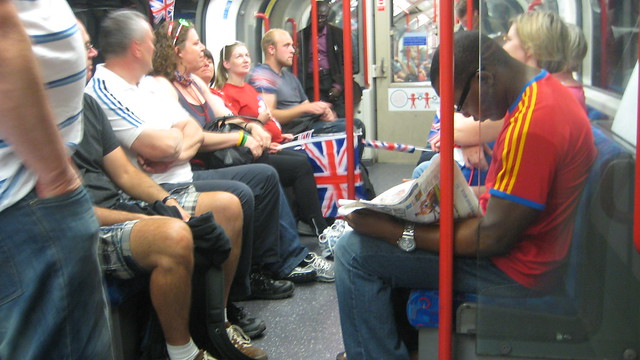 Londoners and Olympics fans intermingle on the Tube