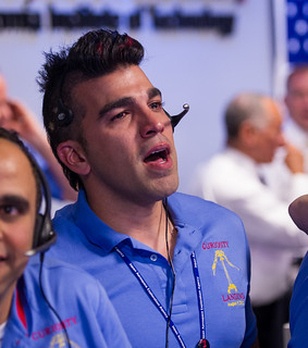 Mars Science Laboratory (MSL) Systems Engineer Bobak Ferdowsi is seen reacting after the MSL rover Curiosity successfully landed on Mars, Sunday, Aug. 5, 2012 at the Jet Propulsion Laboratory in Pasadena, Calif. Photo Credit: (NASA/Bill Ingalls)