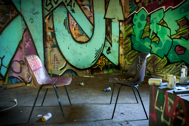 Graffitis, beer botles and plastic chairs