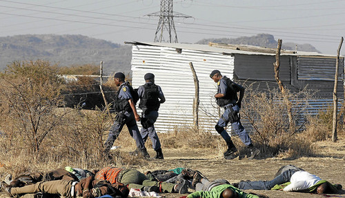 A massacre occured at the Lomnmin platinum mining area where 30 have been reported killed. Police opened fire on striking workers on August 16, 2012. by Pan-African News Wire File Photos