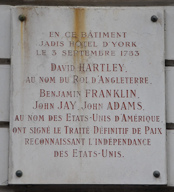 Photo of Benjamin Franklin, John Jay, David Hartley, and John Adams marble plaque
