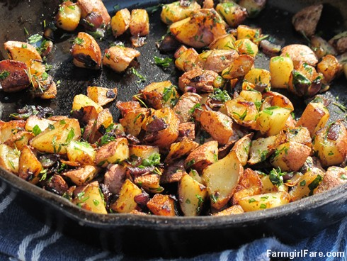 (18-14) Pan fried new potatoes with red onion and herbs from the kitchen garden - FarmgirlFare.com