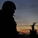 RAF Regiment Soldier Silhouetted in Afghanistan with Chinook Helicopter